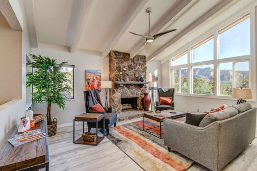 Living Room with Vaulted Ceiling and a Wall of Windows for Plenty of Natural Light and Stunning Sedona Scenery!