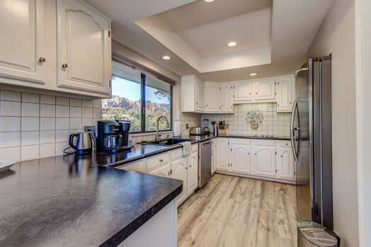 Remodeled and Fully Equipped Kitchen with Ample Counter Space for Meal Prep and Entertaining