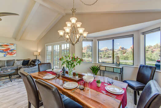Bay Windows Bring in Natural Light and Panoramic Red Rock Views into Both the Family and Dining Rooms