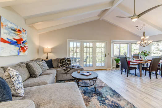Spacious Great Room that is Open and Airy with Vaulted Ceilings, French Doors and Bay Windows