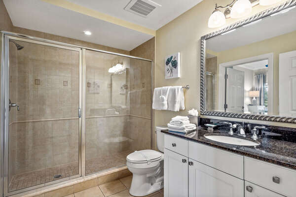 Large shared bathroom in front of condo