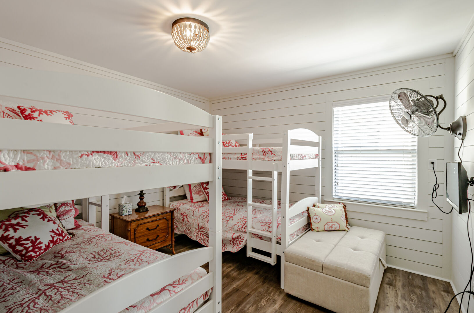 Bedroom 2 features 2 sets of twin bunks.