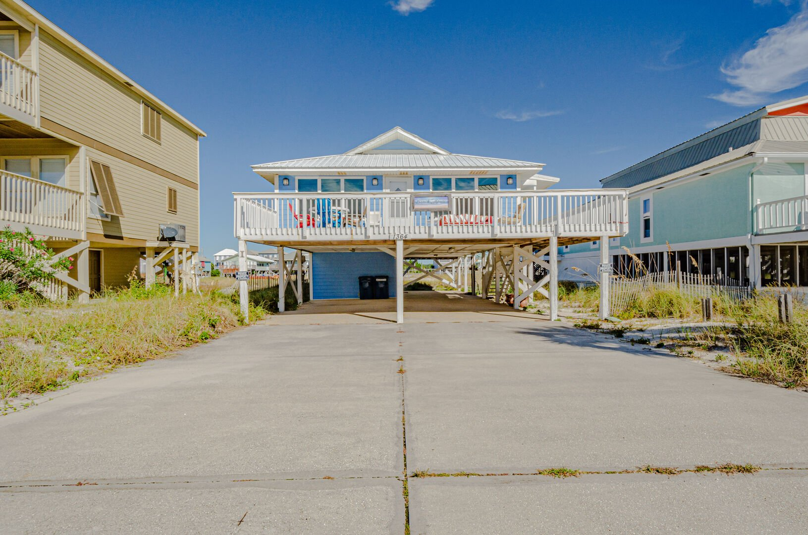 Paved parking of this Gulf Shores Beach House Rental.