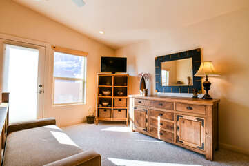 Master Bedroom Entertainment Center with Storage and Outdoor Acess