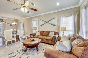Large spacious living room area with a large flat screen t.v
