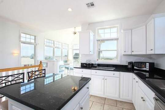 Modern open concept kitchen and dining area with views of the ocean 27 Fiddlers Green Lane-Dennis Port-New England Vacation Rentals