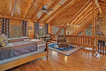 Upstairs loft with 2 twin beds and sitting area.