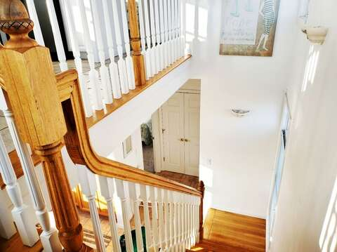 looking down the stairs to the first floor. 27 Fiddlers Green Lane-Dennis Port-New England Vacation Rentals