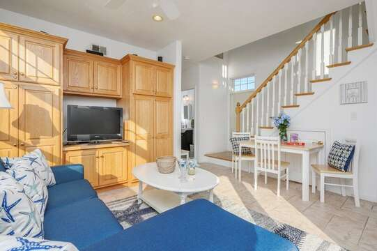 Living room Flat screen tv and large cabinet with games and storage table for extra seating or games. 27 Fiddlers Green Lane-Dennis Port-New England Vacation Rentals