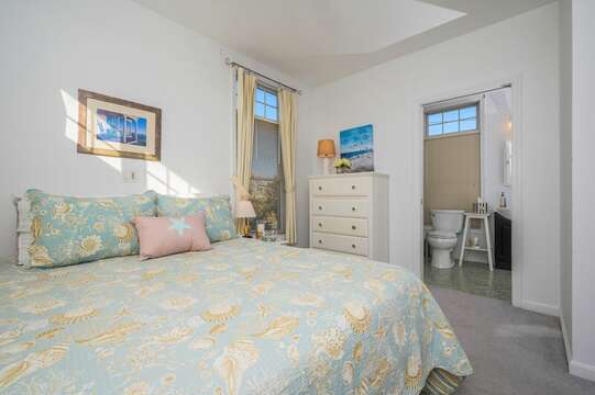 Queen bed on First floor with dresser and entrance to full Bathroom. 27 Fiddlers Green Lane-Dennis Port-New England Vacation Rentals