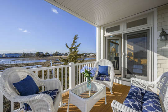 Back deck off of the living room with seating for 5 with wonderful marsh views. 27 Fiddlers Green Lane-Dennis Port-New England Vacation Rentals