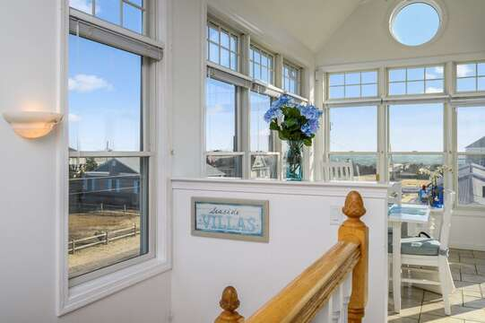 view from top of stairs over looking dining area with grand ocean views.27 Fiddlers Green Lane-Dennis Port-New England Vacation Rentals
