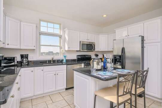 Open concept fully equipped kitchen with stainless fridge, dishwasher and stove with a center island with seating for 2 ,27 Fiddlers Green Lane-Dennis Port-New England Vacation Rentals
