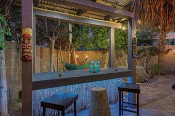 Show off your mixology skills at the outdoor tiki bar with plenty of room and seating for two.