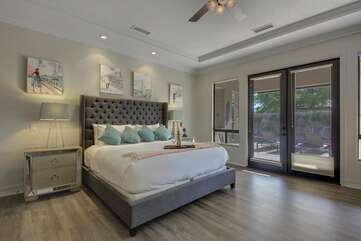 The master suite, which has direct access to the back patio, features a King-sized Bed and 1 Twin Day Bed with a Twin Trundle.