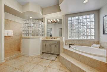 The Master Suite Bath features a soaking tub, tile shower and his and hers vanity sinks.