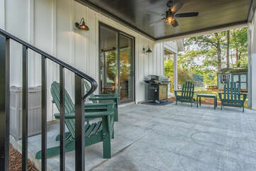 Lower level patio seating, grill provided.