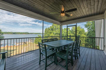 Enjoy dinner with a view!  Main level screened in porch - dining seating.