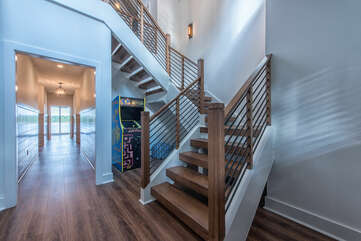 The eye is immediately drawn to the gorgeous staircase and down the long hall to endless Lake Norman views.