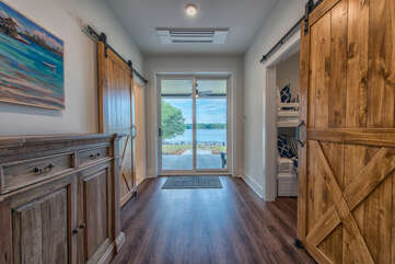 Entering KIDS quarters! End of hall features sliding glass door access to lower level patio.