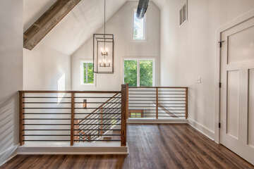 High ceilings, exposed duct work, wood beams - no detail overlooked.