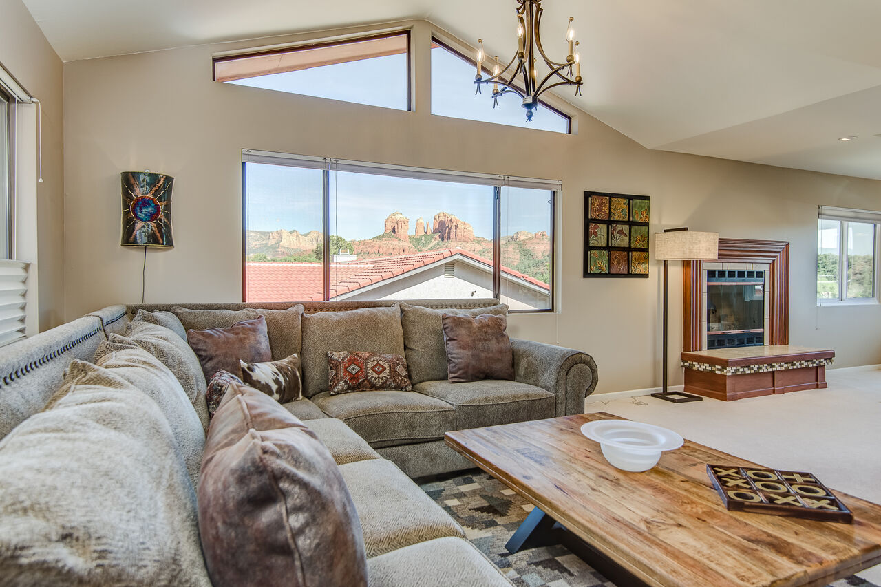 Living Room with a Comfortable Sectional Sofa and Red Rock Views