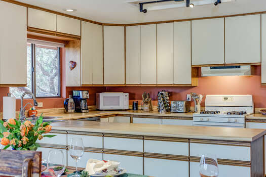 Spacious Kitchen with Plenty of Counter Space for Meal Prep and Entertaining