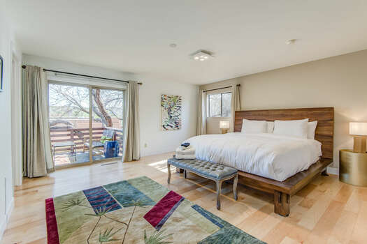 Master Bedroom with a King Bed, Private Balcony and Plenty of Natural Light