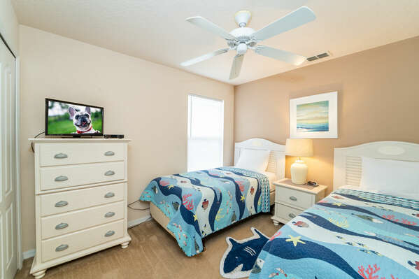 Bedroom 4 has twin beds and a flatscreen TV