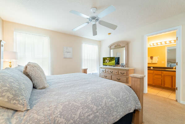 Master bedroom showing TV and bathroom