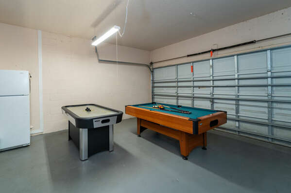 Garage converted to games room with air hockey and pool tables