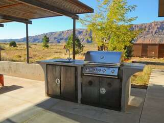 Patio with a private grill and a sink