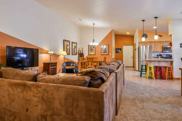 Huge Livingroom with Sectional and Entertainment Center