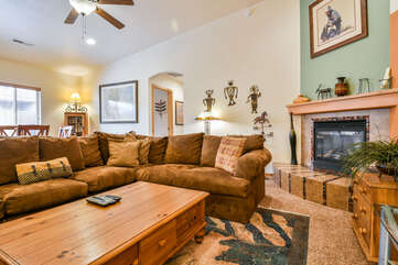 Warm Fireplace and Livingroom with Plenty of Seating