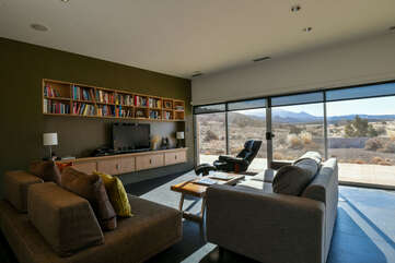 Living room with large windows and lots of books