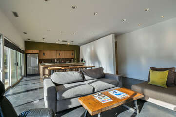 Living room with couches and kitchen