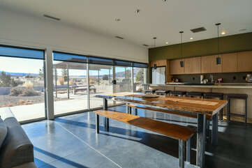 Dining area with large windows and kitchen
