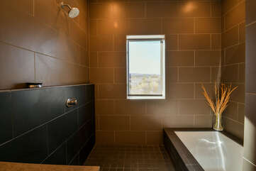 Master bathroom with a bath and shower