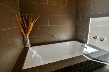 Master bathroom with a bath