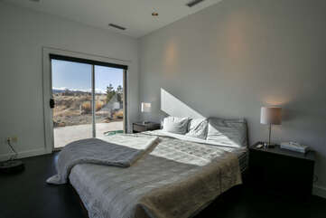 Master bedroom with an entrance to the patio