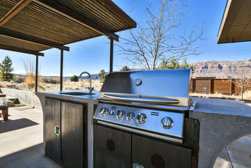 Patio with a gas BBQ and a sink