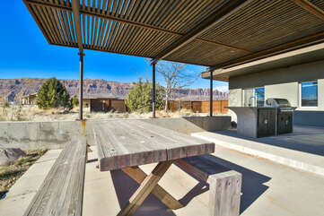 Covered patio with seating and a view