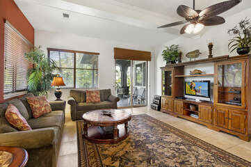 Living Room with Sofas, Coffee Table, Ceiling Fan, and Smart TV