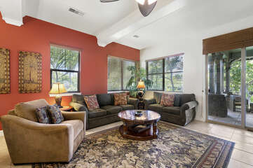 Sofas, Armchair, Ceiling Fan, and Sliding Doors to the Lanai