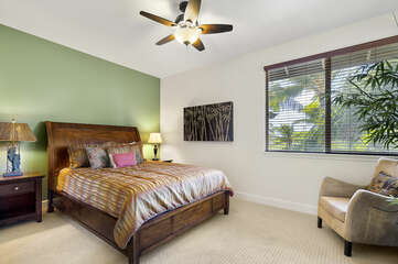 Bedroom with Large Bed, Armchair and Ceiling Fan