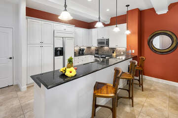Kitchen Breakfast Bar with Seating for Three, Refrigerator, and Microwave