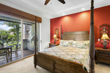 Bedroom with Sliding Doors to the Lanai, Large Bed, and Ceiling Fan