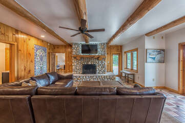 Large comfy leather seating featuring a large built in wood fireplace.