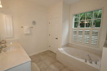 Master Bathroom with Shower, Jetted Tub and His and Her sinks