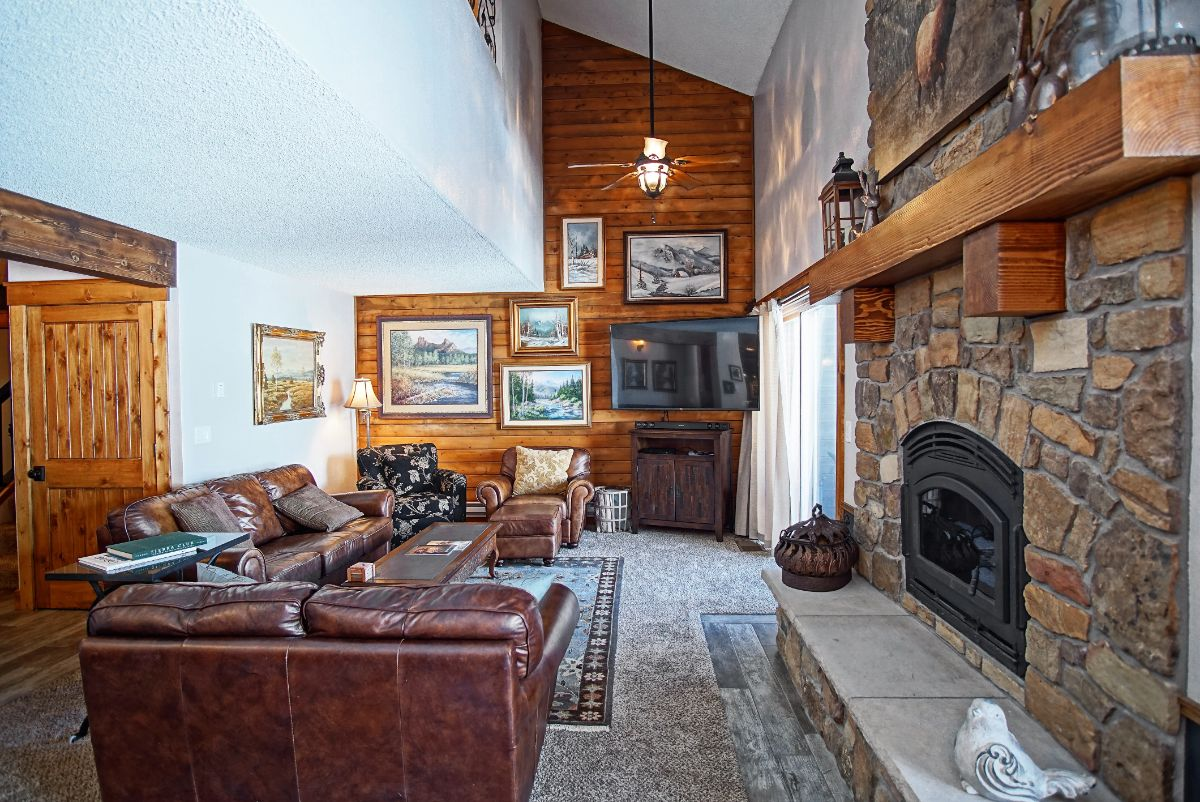 Vaulted ceilings and comfy furniture in the living room